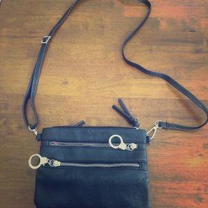Small black purse with handcuff zipper